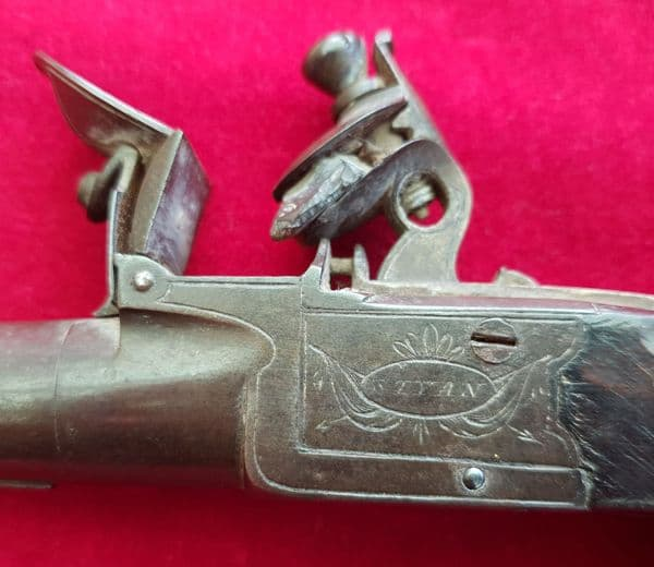 A flintlock pocket pistol with folding trigger by STYAN of Manchester. Circa 1803-1811.  Ref 2139.
